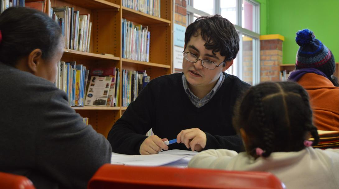 A Law and Human Rights intern assists a South African family on his work abroad programme.